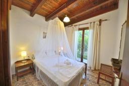 Спальня. Греция, Киссамос Кастели : Бунгало в комплексе с бассейном в 100 метрах от пляжа, с гостиной, отдельной спальней и террасой с видом на море