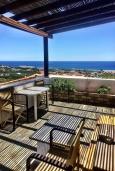 Балкон. Греция, Иерапетра : Апартамент в комплексе с бассейном и барбекю, с гостиной, отдельной спальней и балконом с видом на море