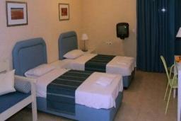 Студия (гостиная+кухня). Греция, Агия Пелагия : Студия в комплексе с бассейном, с балконом с видом на море и горы