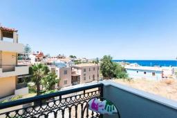 Балкон. Греция, Панормо : Апартамент с гостиной, двумя спальнями и балконом с видом на море
