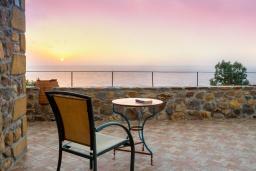 Терраса. Греция, Элафониси : Прекрасная вилла с видом на море, с 4 спальнями, с бассейном, патио и барбекю