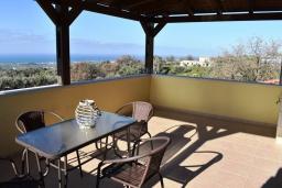 Балкон. Греция, Аделе : Уютный дом с 3-мя спальнями, двумя ванными комнатами и террасой с прекрасным видом