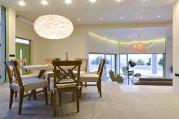 Гостиная. Греция, Айя Пелагия : Роскошная вилла с бассейном и видом на море, 2 спальни, 2 ванные комнаты, барбекю, парковка, Wi-Fi