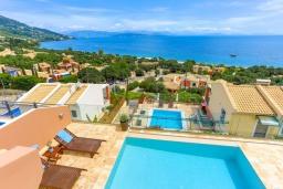 Вид на море. Греция, Барбати : Современная вилла с бассейном и шикарным видом на море, 2 спальни, 2 ванные комнаты, барбекю, парковка, Wi-Fi