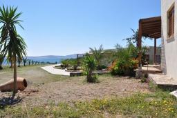 Территория. Греция, Ваи : Апартамент в 50 метрах от пляжа, с гостиной, отдельной спальней и террасой с видом на море